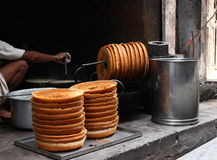 Ghevar, North Indian Sweet. Making of Ghevar, popular Indian Sweet at a street shop Royalty Free Stock Photography