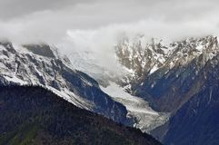 Ghiacciai di Mingyong della montagna della neve di Meili Immagine Stock