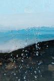 Ghiaccio di fusione su The Creek Fotografia Stock