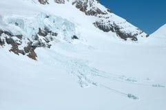 Ghiaccio e neve Jungfraujoch vicino in alpi in Svizzera Fotografia Stock