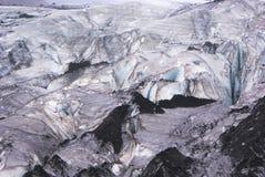 Ghiaccio glaciale con detriti rocciosi Fotografia Stock Libera da Diritti