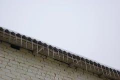 Ghiaccioli sul tetto Fotografie Stock