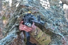 Ghilli Suit Special Forces. A special forces team fires from cover Stock Photo