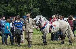 Ghillie and Highland Pony. A Ghillie leading his Highland Pony, at the 2014 Aberfeldy Show and Games, Scotland Royalty Free Stock Photos