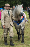 Ghillie and Pony. Stalking Ghillie with his Highland Pony, at 2014 Aberfeldy Show, Scotland Royalty Free Stock Images