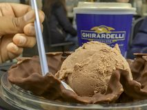 Ghirardelli chocolate ice cream with a mug of takeaway coffee stock photography
