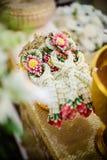 Ghirlanda del fiore per la sposa e lo sposo Fotografie Stock
