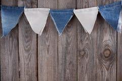 Ghirlanda delle bandiere differenti del denim delle tonalità con spazio per testo Fotografia Stock