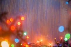 Ghirlanda di celebrazione di Natale delle lampadine Fotografie Stock Libere da Diritti