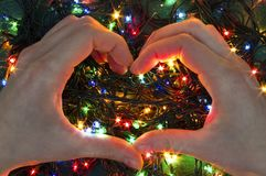 Ghirlande delle luci di Natale dentro il cuore Fotografie Stock