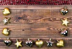 Ghirlande di Natale su un fondo di legno con un posto Fotografie Stock