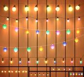 Ghirlande festive su fondo di legno Immagine Stock Libera da Diritti