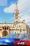 Ghirlandina, dome, sportcar, modena. Original photo by ghirlandina and modena dome with sportcar, italy Royalty Free Stock Photography