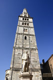 Ghirlandina Tower. Gothic tower of the Romanesque Cathedral of Modena, Italy and the statue of Alexander Tassoni, famous writer Royalty Free Stock Photos