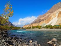 Ghizer River In Autumn, Ghizer Valley, Northern Pakistan. Beautiful Autumn Landscape Of Ghizer River Along Hindu Kush Mountain Range In Ghizer Valley, Northern Royalty Free Stock Photo