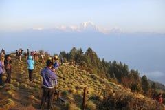 Ghorepani, Nepal - Circa June 2013. People enjoying the sunrise at Poon Hill stock photos
