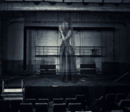 Ghost of actress on stage of old theater. Halloween horror. blured ghost of woman actress on stage of old theater was destroyed Stock Photography