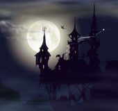 Ghost castle. In full moonlight with flying bats Stock Photo