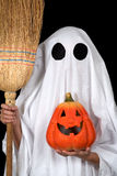 Ghost child. Hold an halloween pumpkin and a broom Stock Images