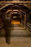 Ghost in Covered Bridge. Ghost of victim walking across the bridge at night royalty free stock image