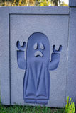A ghost decoration in the wall for halloween Stock Photography