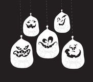 Ghost faces, pumpkin faces Stock Images