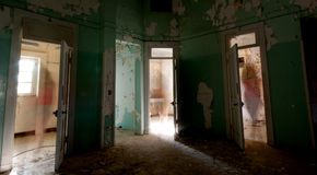 Ghost figures. In an abandoned room Stock Image