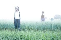 Ghost in The Fog, on the field. Mysterious woman in the Forrest. Reincarnation. royalty free stock photo