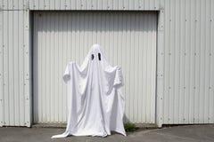 Ghost in garage doorway Royalty Free Stock Photos