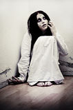 Ghost girl. A scary ghost girl wearing a white nightie Stock Photos