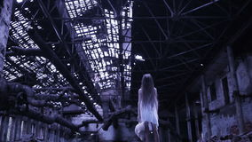 Ghost girl in abandoned building. industrial premises stock video
