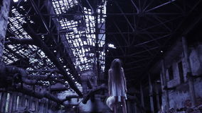 Ghost girl in abandoned building. industrial premises. Ghost girl in abandoned building stock footage