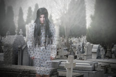Ghost girl in a cemetery Stock Images
