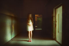 Ghost girl in front of spooky light Royalty Free Stock Images