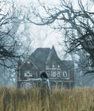 Ghost girl with haunted house scene in creepy forest stock images
