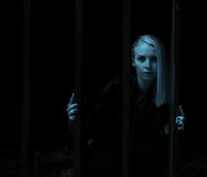 Ghost girl trapped behind bars Stock Photography