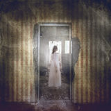Ghost girl in white appears in the room Stock Photography