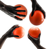 Ghost hand with orange balloons Stock Photography