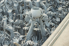 Ghost hands from hell, Conceptual sculpture decorations in Rongkhun Temple Chiangrai, Thailand Stock Photos