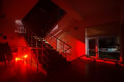 Ghost in Haunted House at stairs, Mysterious silhouette of ghost man with light at stairs, Horror scene of scary ghost spooky llig. Hts . Scary hall. Halloween Royalty Free Stock Image