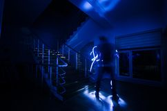 Ghost in Haunted House at stairs, Mysterious silhouette of ghost man with light at stairs, Horror scene of scary ghost spooky llig stock photography