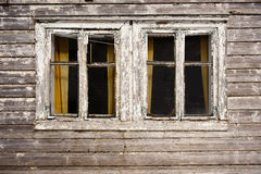 Ghost house. Two dark windows in old haunted house Stock Images