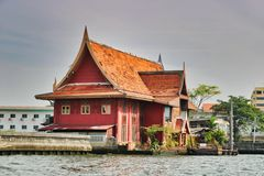 Ghost House in Bangkok Thailand. This unique photo shows how the old Bangkok looks like and how people live in simple circumstances on the Mae Nam Chao Phraya royalty free stock image