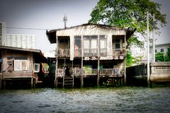 Ghost House in Bangkok Thailand. This unique photo shows how the old Bangkok looks like and how people live in simple circumstances on the Mae Nam Chao Phraya royalty free stock photography