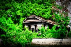Ghost House in Bangkok Thailand. This unique photo shows how the old Bangkok looks like and how people live in simple circumstances on the Mae Nam Chao Phraya royalty free stock photo