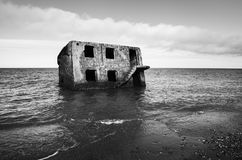 Ghost house on water. Stock Photo