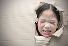 Ghost kid sad and through hole on cardboard. Stock Photography