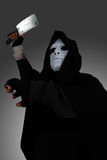 Ghost Killer man in mask and hood hold chopping knife, costume for Halloween night Royalty Free Stock Photography