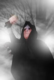 Ghost Killer man in mask and hood hold chopping knife, costume for Halloween night Stock Image