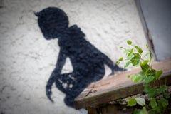 Ghost of little boy. Of lost city Pripyat. Chernobyl area. Modern ruins.Graffiti. Ukraine. Kiev region Royalty Free Stock Photos